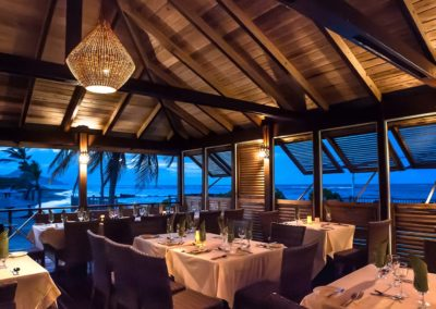 Oceanside dining at sunset at Nisbet Plantation Beach Club