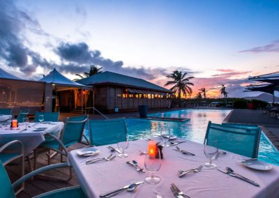 Poolside dining at sunset at Nisbet Plantation Beach Club Nevis